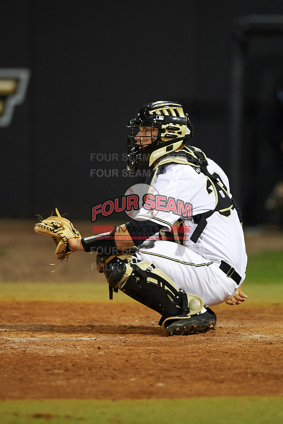 UCF Knights catcher Dallas Beaver (38) waits for a warmup pitch during a game against the Siena Saints on February 17, 2017 at UCF Baseball Complex in Orlando, Florida.  UCF defeated Siena 17-6.  (Mike Janes/Four Seam Images)