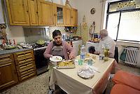Roma, 29 Marzo 2014<br /> Centocelle<br /> Le e gli occupanti del palazzo sgomberato e messo sotto sequestro il 19 Marzo scorso e poi rientrate/i con dissequestro temporaneo,  organizzano una festa aperta alla cittadinanza.<br /> Marcella e il marito vivono nella stanza trasformata in casa  da 5 anni.<br /> House, the occupation of Via delle Acacie open to the city.