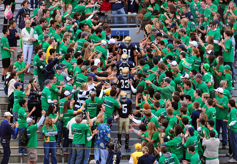 The team enters the stadium through the student section for warmups...Photo by Matt Cashore