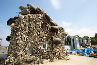 The destroyed tsunami gates covered with seaweed in Minamisanriku, Myiagi, Japan. The fishing port of Minamisanriku, Miyagi, Japan was devastated by the tsunami where the popultion was reduced from 18,000 to about 8,000.<br /> <br /> Richard Jones  / Sinopix