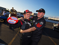 Feb 8, 2015; Pomona, CA, USA; NHRA top alcohol funny car driver Jonnie Lindberg celebrates with his crew after winning the Winternationals at Auto Club Raceway at Pomona. Mandatory Credit: Mark J. Rebilas-USA TODAY Sports