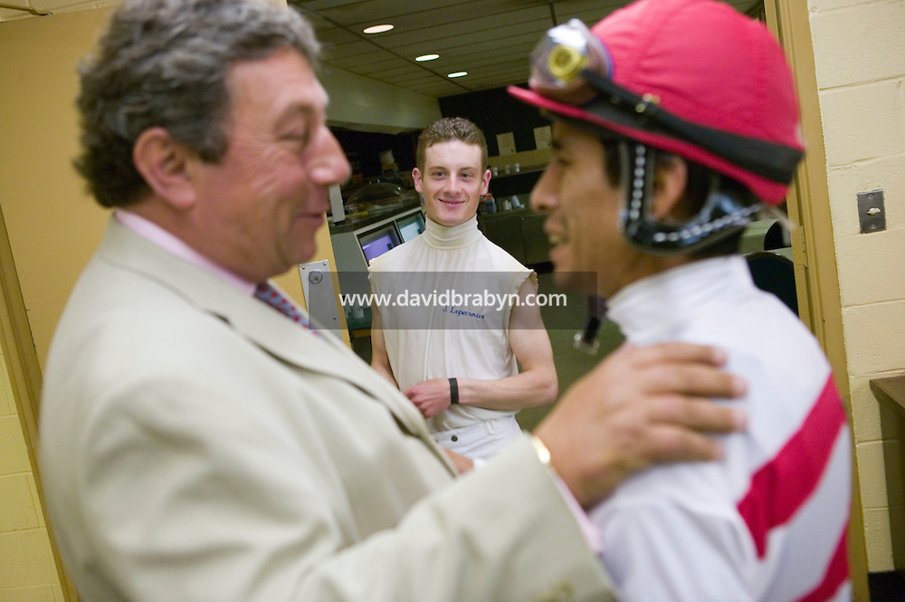 27 May 2006 - ELMONT, NY - 22 year-old French apprentice jockey Julien Leparoux (C) looks on as trainer Patrick Biancone talks to Edgar Prado in the scales room at Belmont Park hippodrome in Elmont, outside New York City, USA, 27 May 2006.