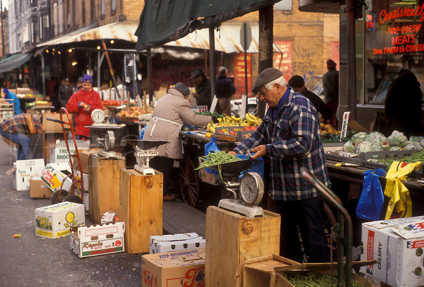 AJ3524, Philadelphia, outdoor market, Pennsylvania, Man selling fresh produce at the Italian Market in Philadelphia in the state of Pennsylvania.