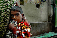INDIA (West Bengal - Calcutta) -Raja is a young boy from Sonagachi in Kolkata, Her mother died of Aids who was a sex worker. Fortunately the boy is not affected by the disease. Now he is looked after by a retired sex worker who was their neighbour. Kolkata, India- Arindam Mukherjee