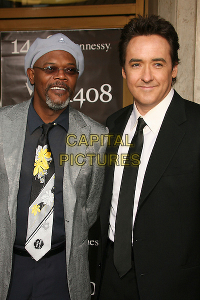 "SAMUEL L. JACKSON & JOHN CUSACK.""1408"" World Premiere at Mann's National Theatre, Westwood, California, USA..June 12th, 2007.half length black suit jacket tie grey gray hat tinted glasses goatee facial hair floral print tie sunglasses shades silver.CAP/ADM/BP.©Byron Purvis/AdMedia/Capital Pictures"