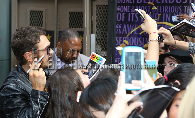 James Franco greets his fans after a matinee performance in 'Of Mice And Men' at the Longacre Theatre  on June 18, 2014 in New York City..