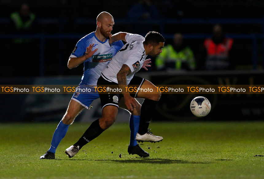 Jason Taylor (L) of Barrow challenges Jai Reason during Dover Athletic vs Barrow, Vanarama National League Football at the Crabble Athletic Ground on 4th February 2020
