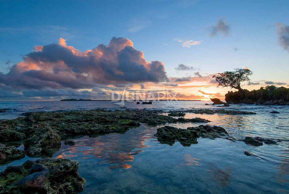Sunset at Kerehikapa Island, view towards Sikopo Island.