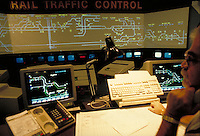 Operators monitoring rail traffic in Houston area via computerized projection system. Houston Texas USA Union Station - Houston Belt and Terminal.