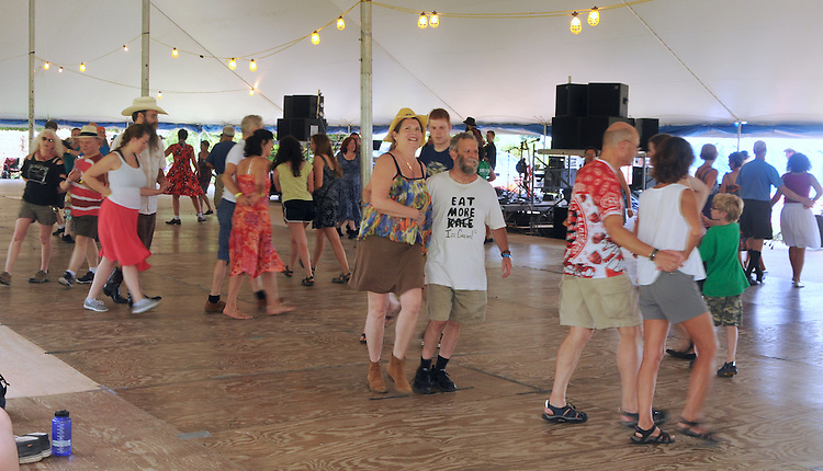 Square Dancing in the Dance Tent at the Falcon Ridge Folk Festival, held on Dodd's Farm in Hillsdale, NY on Friday July 31, Saturday August 1, and Sunday, August 2, 2015. Photo by Jim Peppler. Copyright Jim Peppler 2015.