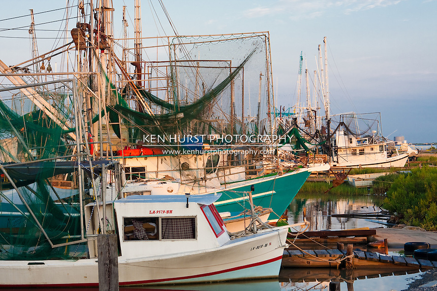 Shrimp boats lined up at dock in Cameron, Louisiana on the Gulf Of Mexico.