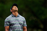 AUGUSTA, GA - APRIL 8:  Tiger Woods reacts after hitting onto the green during the 2010 Masters Tournament held in Augusta, Georgia at Augusta National Golf Club on April 8, 2010. (Photo by Donald Miralle)..