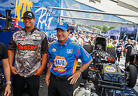 May 14, 2016; Commerce, GA, USA; NHRA funny car driver Matt Hagan (left) and teammate Ron Capps in the pits during qualifying for the Southern Nationals at Atlanta Dragway. Mandatory Credit: Mark J. Rebilas-USA TODAY Sports
