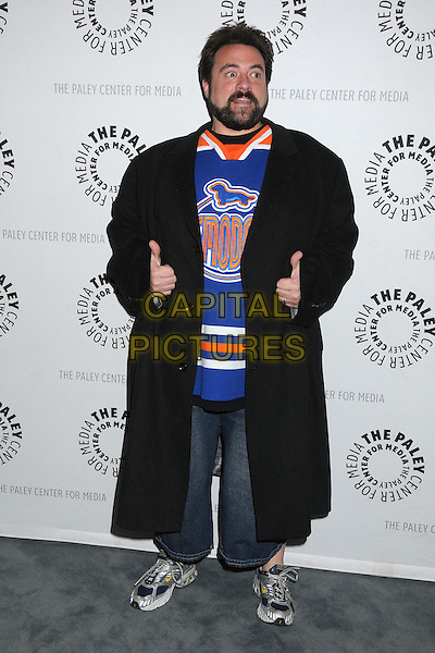"""Kevin Smith.""""Batman: The Dark Knight Returns, Part 2"""" Los Angeles Premiere held at The Paley Center, Beverly Hills, California, USA..January 28th, 2013.full length black long coat blue top jeans denim beard facial hair hands thumbs up  white orange.CAP/ADM/BP.©Byron Purvis/AdMedia/Capital Pictures."""