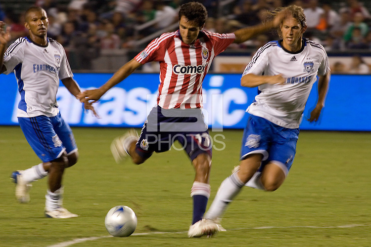 Chivas USA defender Jonathan Bornstein (13) takes a shot on goal during a MLS match. The San Jose Earthquakes and Chivas USA played to 0-0 draw at Home Depot Center stadium on Saturday, August 23, 2008.