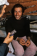 Newport RI, US - July 7, 1972. French navigator Alain Colas aboard his trimaran Pen Duick IV (previously owned by sailing legend Éric Tabarly) winning the 1972 Transat Plymouth-Newport race. Alain Colas (September 16, 1943 - November 16, 1978) was the first sailor to complete a solitary round the world race in a multihull and endeavored to complete the 1978 Route du Rhum, however disappeared in the Atlantic after passing Azores.