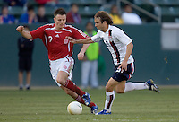 Justin Mapp dribbles the ball as William Kvist Jorgensen closes in. The USA defeated Denmark 3-1 in an International friendly at the Home Depot Center in Carson, CA on January 20, 2007.