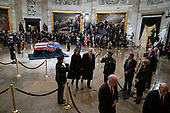 WASHINGTON, DC - DECEMBER 3 : President Donald J. Trump and first lady Melania Trump depart after paying their respects to former president George H.W. Bush as he lies in State at the U.S. Capitol Rotunda on Capitol Hill on Monday, Dec. 03, 2018 in Washington, DC. (Photo by Jabin Botsford/Pool)
