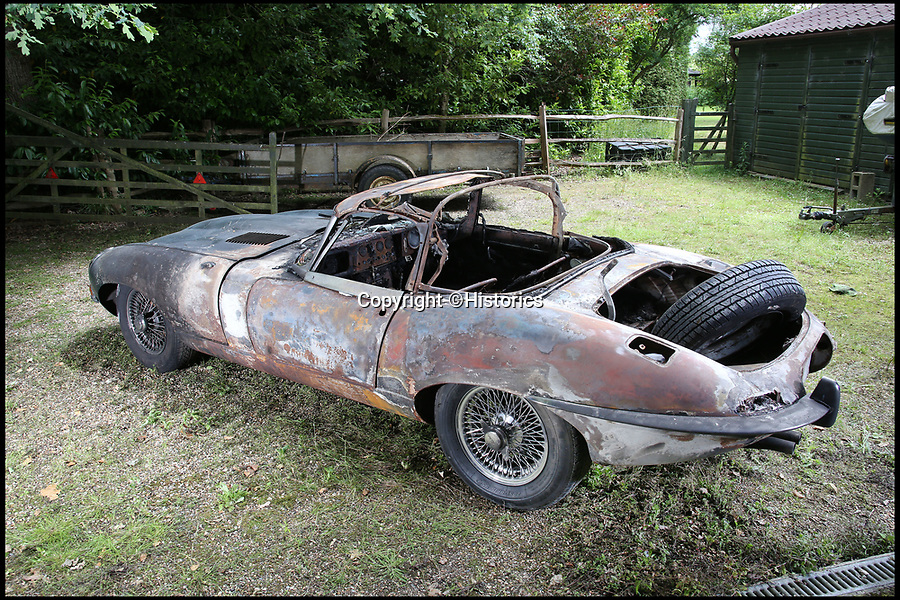 BNPS.co.uk (01202 558833)Pic: Historics/BNPS<br /> <br /> A freak fire during a respray has left this classic E-type Jaguar in tatters.<br /> <br /> Hot wheels...<br /> <br /> A vintage E-type Jaguar has been put up for sale for £32,000 after a freak fire during a respray left it in tatters.<br /> <br /> The classic open top caught fire after its fuel leaked and came into contact with sparks created by welding.<br /> <br /> It had been with its owner since 1986 but but he has now seen his classic vehicle completely ruined.<br /> <br /> It is thought he had been contemplating a respray for some time before finally making the decision to go through with the work.<br /> <br /> The disaster occurred as the team of mechanics were disassembling the Jaguar ready to paint, when when one of them accidentally cut through its fuel line.