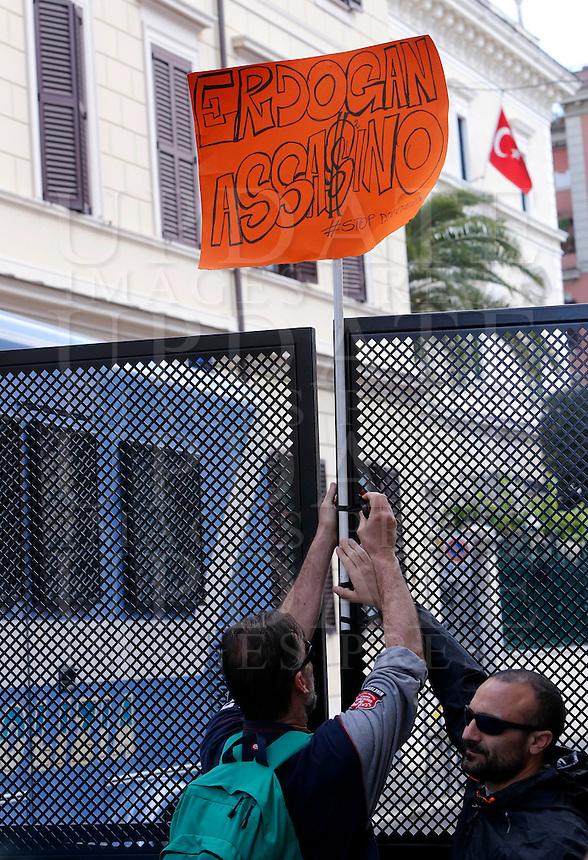 "Manifestazione davanti all'ambasciata turca per protestare contro gli accordi tra Unione Europea e Turchia sui migranti, a Roma, 1 maggio 2016.<br /> Demonstrators put a sign reading ""Erdogan assassin"", aimed to Turkish President Recep Tayyip Erdogan, in front of the Turkish Embassy, during a protest against the agreement between the EU and Turkey on migrants in Rome, 1 May 2016.<br /> UPDATE IMAGES PRESS/Riccardo De Luca"