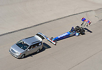 Sept. 29, 2012; Madison, IL, USA: NHRA top fuel dragster driver T.J. Zizzo being towed back to the pits during qualifying for the Midwest Nationals at Gateway Motorsports Park. Mandatory Credit: Mark J. Rebilas-