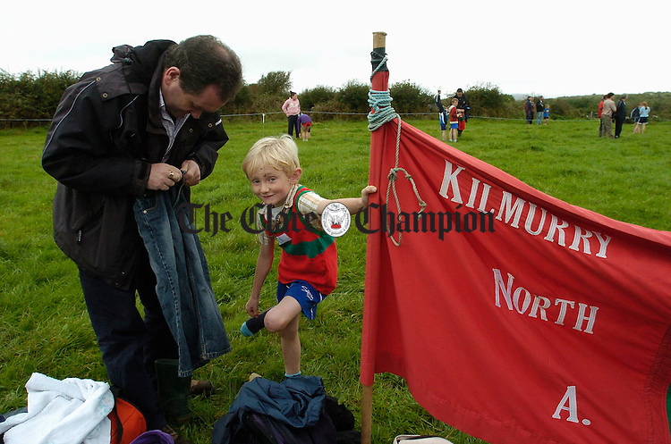 DJ Flanagan helping his son Cian, who runs with Kilmurry Ibrickane