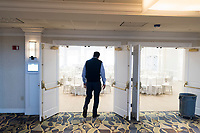 Owner George Filopoulos walks into the newly renovated Rose Island Ballroom at Gurney's Newport Resort and Marina, which was formerly a Hyatt Regency hotel, on Goat Island in Newport, Rhode Island, on Wed., April 19, 2017. The entire hotel will be renewed with an approximately $18 million renovation to be completed by Memorial Day 2017. Almost everything in the ballroom was replaced. The old carpeting that is being replaced throughout the hotel can be seen in the foreground.