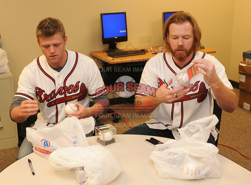 Tyler Pastornicky and Tommy Hanson of the Atlanta Braves sign autographs for fans on January 27, 2012 at Academy Sports and Outdoors in Spartanburg, South Carolina. It was the first day of the 2012 Braves Country Caravan, which visits cities all across the South prior to Spring Training. (Tom Priddy/Four Seam Images)