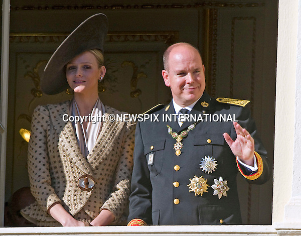"Charlene Wittstock and Prince Albert II of Monaco.MONACO NATIONAL DAY 2010 (Fête Nationale Monégasque 2010).The Royal Family greet the crowds and watch the Army Parade from the balcony of the Prince's palace as part of Monaco's National Day celebrations. Monaco_19/11/2010..Mandatory Photo Credit: ©Dias/Newspix International..**ALL FEES PAYABLE TO: ""NEWSPIX INTERNATIONAL""**..PHOTO CREDIT MANDATORY!!: NEWSPIX INTERNATIONAL(Failure to credit will incur a surcharge of 100% of reproduction fees)..IMMEDIATE CONFIRMATION OF USAGE REQUIRED:.Newspix International, 31 Chinnery Hill, Bishop's Stortford, ENGLAND CM23 3PS.Tel:+441279 324672  ; Fax: +441279656877.Mobile:  0777568 1153.e-mail: info@newspixinternational.co.uk"