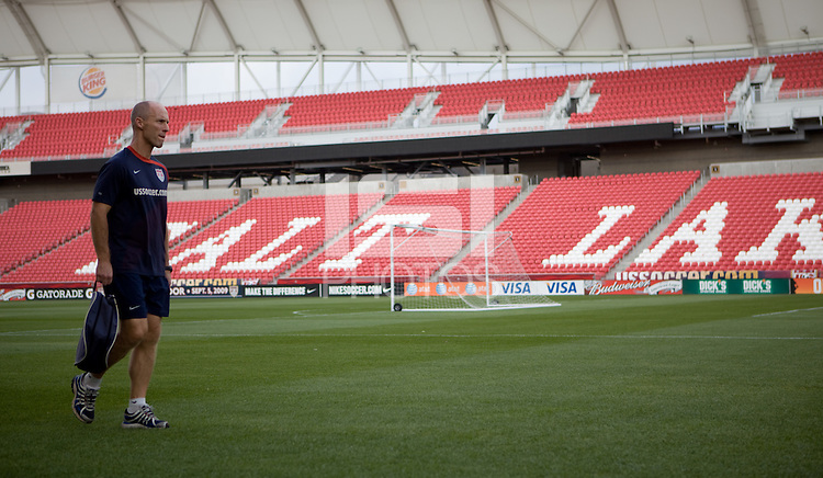 Bob Bradley walks off the field after the .USMNT practice for the USA vs El Salvador World Cup Qualifying match at Rio Tinto Stadium, in Sandy, Utah, Friday, September 4, 2009.