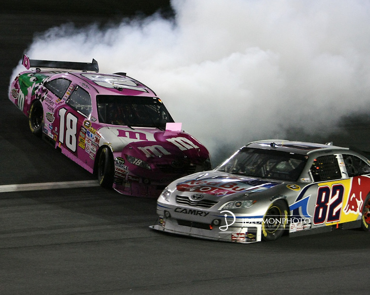 Oct. 17, 2009; Kyle Busch spins in turn four barely missing Brian Vickers at the NASCAR Banking 500 Sprint Cup Series event sponsored by Bank of America,  run at  Lowe's Motor Speedway in Charlotte, NC., Banking 500