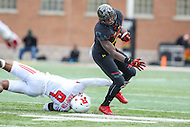 College Park, MD - November 26, 2016: Maryland Terrapins running back Wes Brown (5) breaks Rutgers Scarlet Knights defensive back Saquan Hampton (9) tackle during game between Rutgers and Maryland at  Capital One Field at Maryland Stadium in College Park, MD.  (Photo by Elliott Brown/Media Images International)