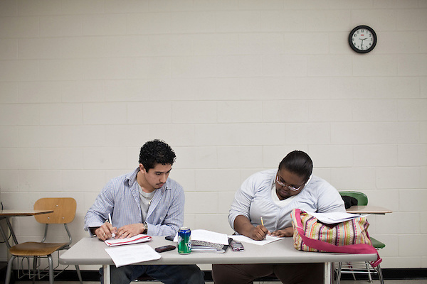 December 09, 2009. Pinehurst, North Carolina.. Students in the SandHoke Early College High School attend classes at Sandhills Community College for their last year of high school and will graduate with a high school diploma, as well as an associates degree.. (left to right) Javier Cruz and Tiana Purcell work on notes for the upcoming biology final on Friday.
