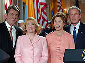 Washington, D.C. - April 4, 2005 -- United States President George W. Bush and President Viktor Yushchenko of Ukraine pose for a photo follwing a joint press conference in the East Room at the White House in Washington, D.C. on April 4, 2005.  Their discussions were to include the spread of democracy in Eastern Europe and the Middle East and curbing the spread of weapons. Left to right: President Yushchenko; Kathy Chumachenko, wife of President Yushchenko; first lady Laura Bush; President Bush.<br /> Credit: Ron Sachs / CNP