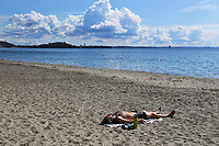 1st April 2020, Kohi Beach, Auckland, New Zealand;  Sun bather at Kohi Beach during the warm weather during the lockdown due to Covid-19. Kohimarama, Auckland, New Zealand on Wednesday 1 April 2020.