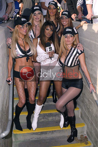 Traci Bingham and referees