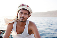 Local guide on a fishing boat in the early morning, Arhur, Socotra, Yemen