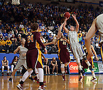 BROOKINGS, SD - MARCH 27:  Megan Waytashek #24 from South Dakota State University shoots over Sari Noga #21 from the University of Minnesota in the first half of their sweet sixteen gameThursday night at Frost Arena in Brookings. (Photo by Dave Eggen/Inertia)