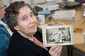 Madge Davison with a photograph of herself at East Row School in 1930.  Open Age reminiscence session at the WECH Community Centre
