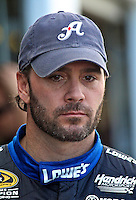 5-time Champion Jimmie Johnson in the garage area during NASCAR Sprint Cup winter testing at Daytona International Speedway, Daytona Beach, FL January 20, 2011.  (Photo by Brian Cleary/www.bcpix.com)