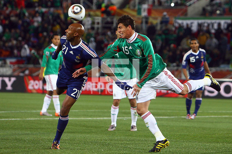 Hector Moreno (R) of Mexico and Nicolas Anelka (L) of France