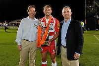 20130809 Copyright onEdition 2013 ©<br /> Free for editorial use image, please credit: onEdition.<br /> <br /> Martyn Thomas of Gloucester Rugby 7s (centre) stands with Mark McCafferty, Chief Executive at Premiership Rugby (left), and Mike Parsons, Head of Retail Sales J.P. Morgan Asset Management,during the finals of the J.P. Morgan Asset Management Premiership Rugby 7s Series.<br /> <br /> The J.P. Morgan Asset Management Premiership Rugby 7s Series kicked off for the fourth season on Thursday 1st August with Pool A at Kingsholm, Gloucester with Pool B being played at Franklin's Gardens, Northampton on Friday 2nd August, Pool C at Allianz Park, Saracens home ground, on Saturday 3rd August and the Final being played at The Recreation Ground, Bath on Friday 9th August. The innovative tournament, which involves all 12 Premiership Rugby clubs, offers a fantastic platform for some of the country's finest young athletes to be exposed to the excitement, pressures and skills required to compete at an elite level.<br /> <br /> The 12 Premiership Rugby clubs are divided into three groups for the tournament, with the winner and runner up of each regional event going through to the Final. There are six games each evening, with each match consisting of two 7 minute halves with a 2 minute break at half time.<br /> <br /> For additional images please go to: http://www.w-w-i.com/jp_morgan_premiership_sevens/<br /> <br /> For press contacts contact: Beth Begg at brandRapport on D: +44 (0)20 7932 5813 M: +44 (0)7900 88231 E: BBegg@brand-rapport.com<br /> <br /> If you require a higher resolution image or you have any other onEdition photographic enquiries, please contact onEdition on 0845 900 2 900 or email info@onEdition.com<br /> This image is copyright the onEdition 2013©.<br /> <br /> This image has been supplied by onEdition and must be credited onEdition. The author is asserting his full Moral rights in relation to the publication of this image. Rights for onward transmission of any image or file is not granted or implied. Changing or deleting Copyright information is