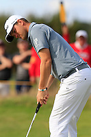 Bernd Wiesberger (AUT) takes his birdie putt on the 14th green during Thursday's Round 1 of the 145th Open Championship held at Royal Troon Golf Club, Troon, Ayreshire, Scotland. 14th July 2016.<br /> Picture: Eoin Clarke | Golffile<br /> <br /> <br /> All photos usage must carry mandatory copyright credit (&copy; Golffile | Eoin Clarke)