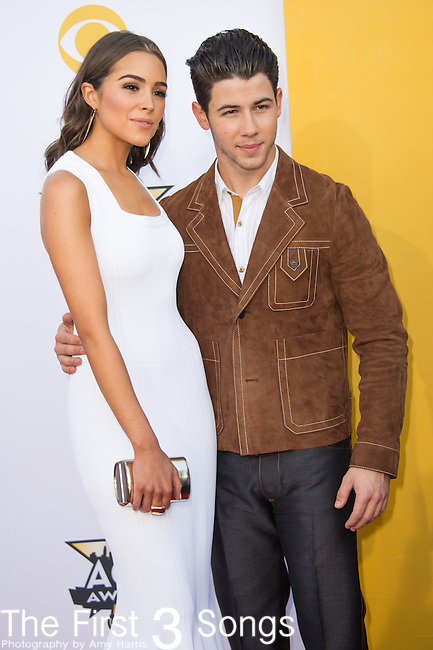 Olivia Culpo and Nick Jonas attend the 50th Academy Of Country Music Awards at AT&T Stadium on April 19, 2015 in Arlington, Texas.