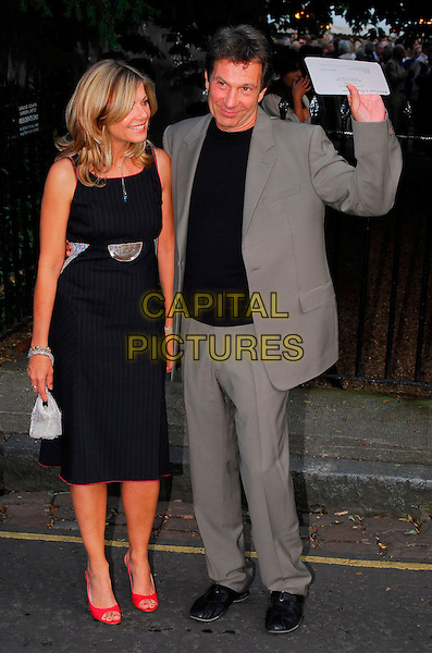 GLYNIS BARBER & MICHAEL BRANDON.Sir David Frost Summer Party, Carlyle Square, London, UK..July 5th, 2006.Ref: CAN.full length black dress grey gray suit red shoes.www.capitalpictures.com.sales@capitalpictures.com.©Capital Pictures
