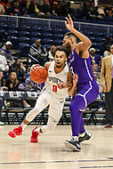 Washington, DC - December 22, 2018: Richmond Spiders guard Jacob Gilyard (0) drives to the basket during the DC Hoops Fest between Hampton and Howard at  Entertainment and Sports Arena in Washington, DC.   (Photo by Elliott Brown/Media Images International)