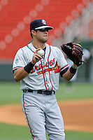 Center fielder Connor Oliver (5) of the Rome Braves warms up before a game against the Greenville Drive on Sunday, June 14, 2015, at Fluor Field at the West End in Greenville, South Carolina. Rome won, 5-2. (Tom Priddy/Four Seam Images)