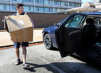 Diego Castro, a freshman from the University of Arkansas, packs his belongings into his car Tuesday, March 24, 2020, from his dorm on the campus in Fayetteville. Students are required to move out of university-managed housing by April 3 as part of the campus response to covid-19.. Visit nwaonline.com/200325Daily/ and nwadg.com/photos for a photo gallery.<br /> (NWA Democrat-Gazette/David Gottschalk)