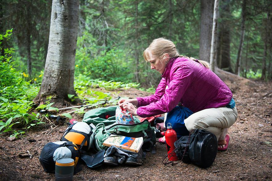 Christine Marozick, of Bozeman, Montana, loads her backpack while hiking in the Bob Marshall Wilderness near Big Salmon Lake.
