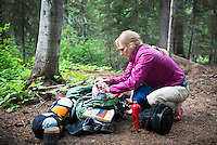 Christine Marozick, of Bozeman, Montana, loads her backpack while hiking in the Bob Marshall Wilderness near Big Salmon Lake.